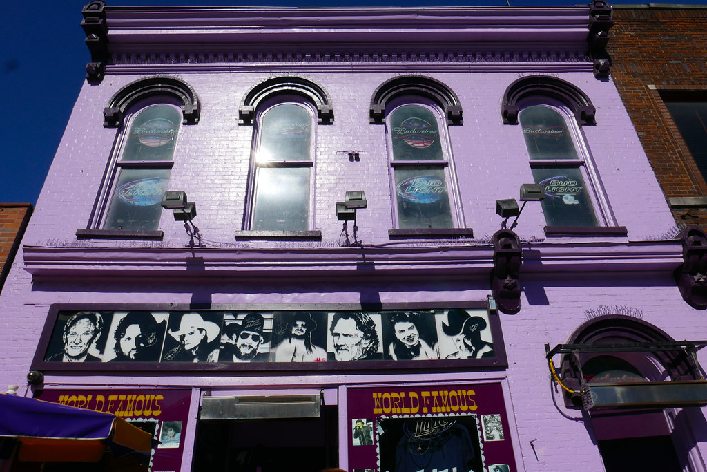 This daytime external shot of Tootsies, ORchid Lounge in Nashville shows the second floor windows as well as the lurid pink paint job